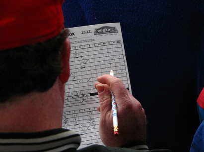 man scoring baseball game by hand