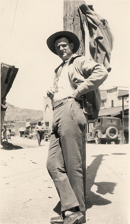 vintage man in hat standing at telephone pole