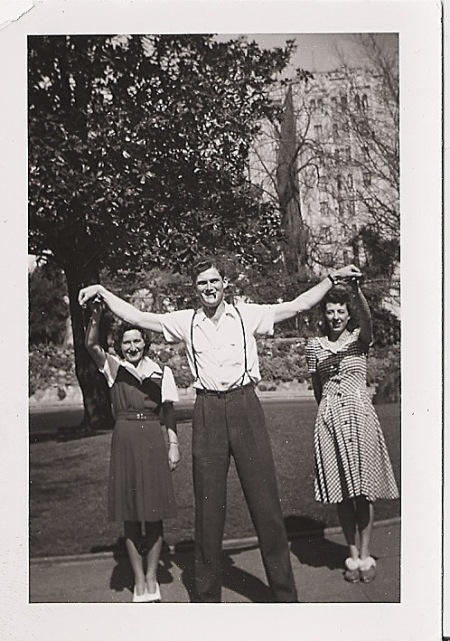 vintage tall young man with two young women