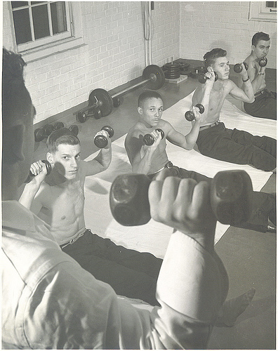 vintage military gym young men lifting weights