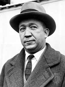 knute rockne in suit and fedora