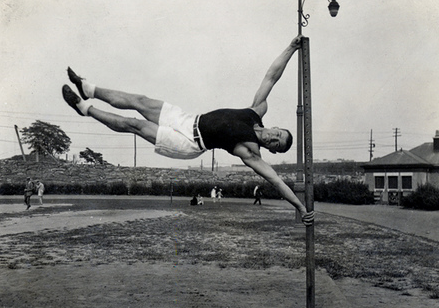 vintage strong man gymnast