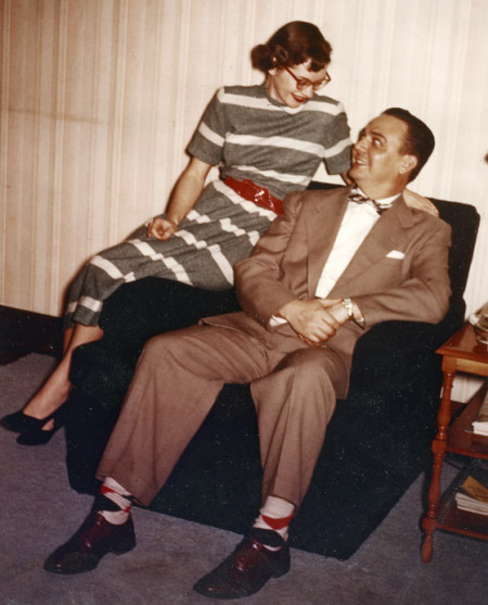 1960s couple sitting in chair man wearing argyle socks