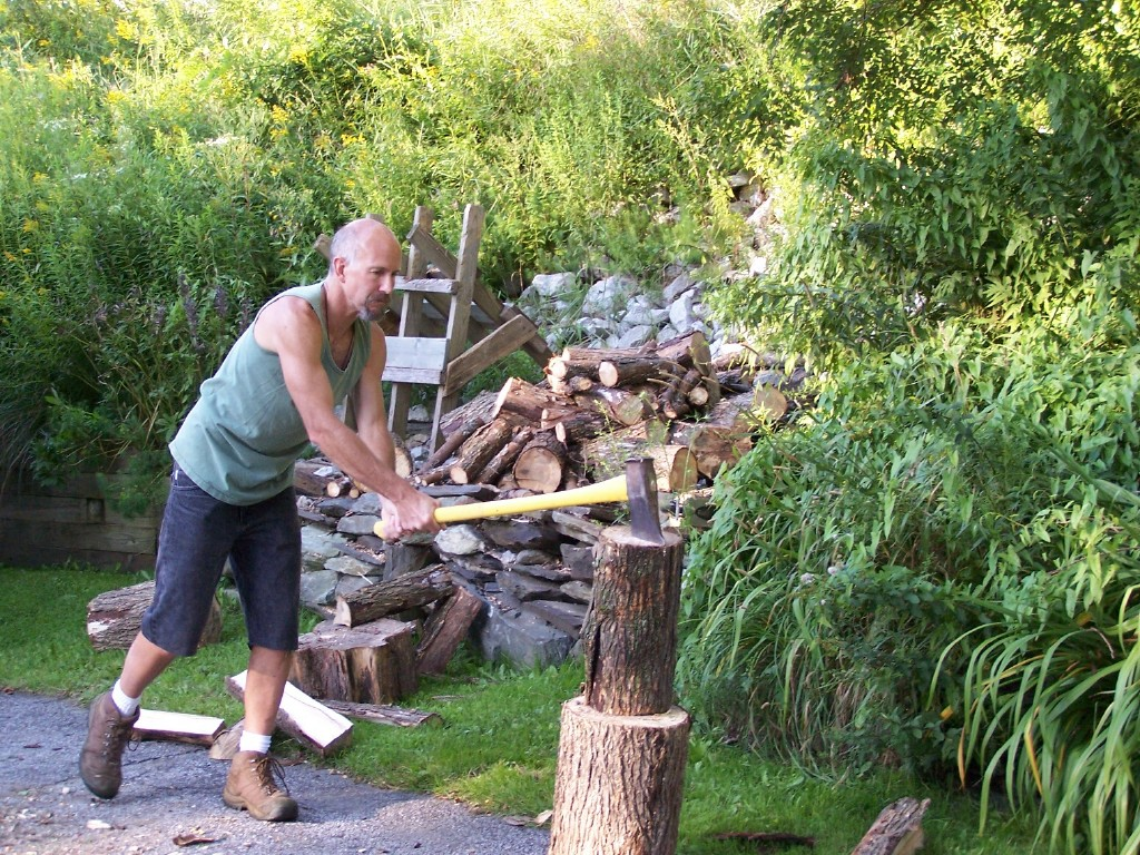 Uncle buzz splitting wood get workout outdoors.
