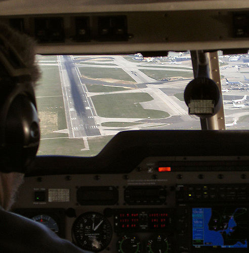 approaching runway from airplane cockpit