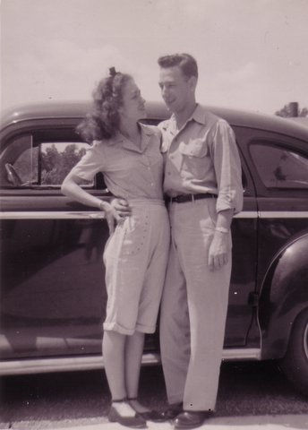 vintage young couple in front of car 1940s 1950s