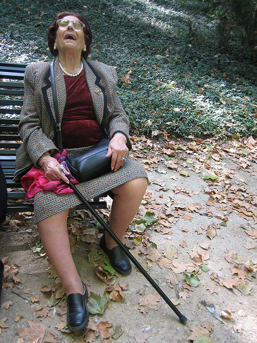 grandma on a bench with a cane