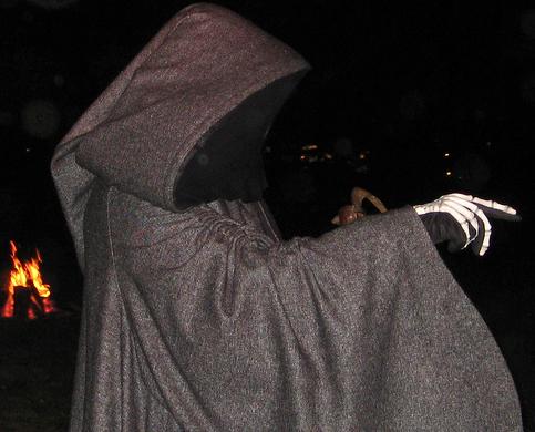 halloween man dressed as grim reaper scare people