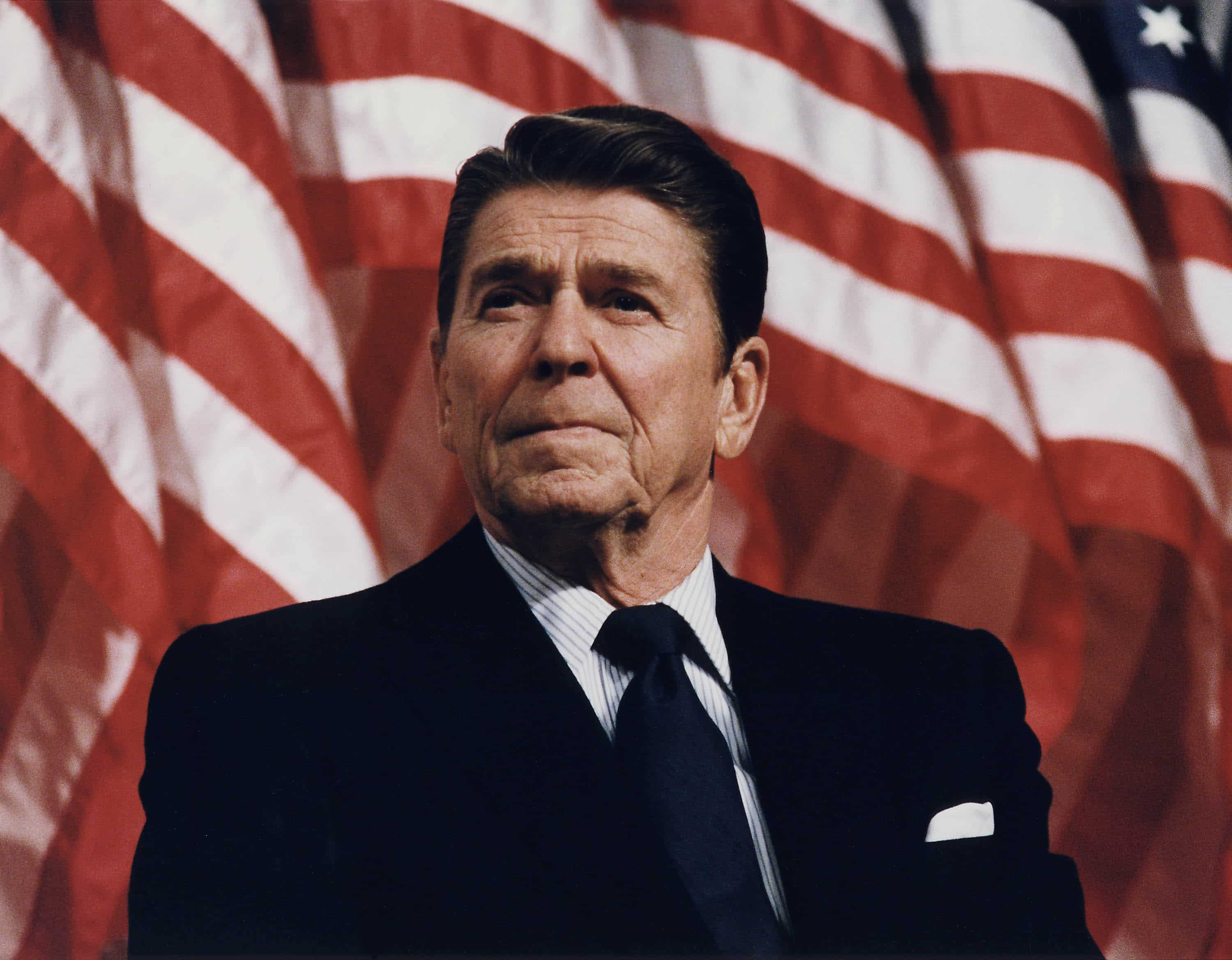 ronald reagan at durenberger rally us flag backdrop