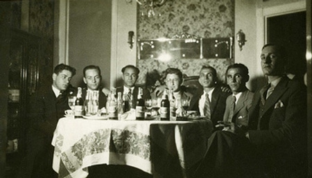 Vintage men group photo at dinner table.