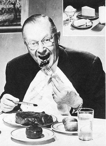older man eating streak dinner 1950s