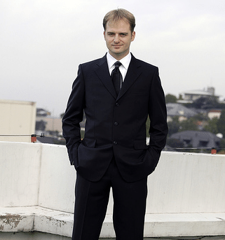 man wearing black tie optional dress dark suit