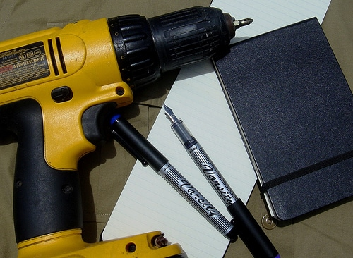 cordless electric drill with varsity fountain pens notebook