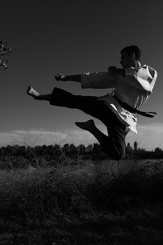 flying kick outdoors karate martial arts black white
