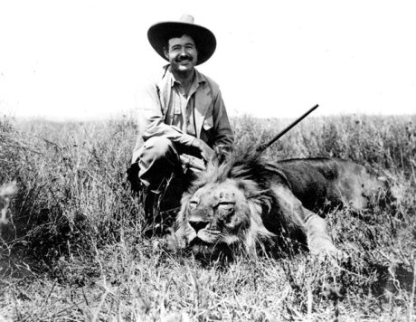 young ernest hemingway on safari with killed lion
