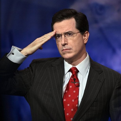 stephen colbert report character saluting suit tie