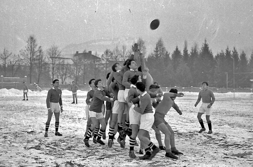 vintage rugby team in snow scrum early 1900s