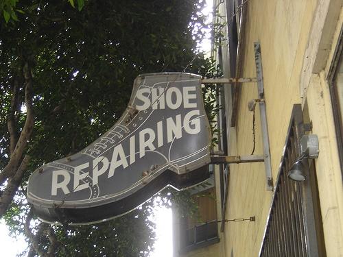 shoe repair repairing sign cobbler shop