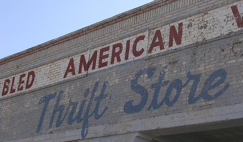 vintage thrift store sign color photo brick facade