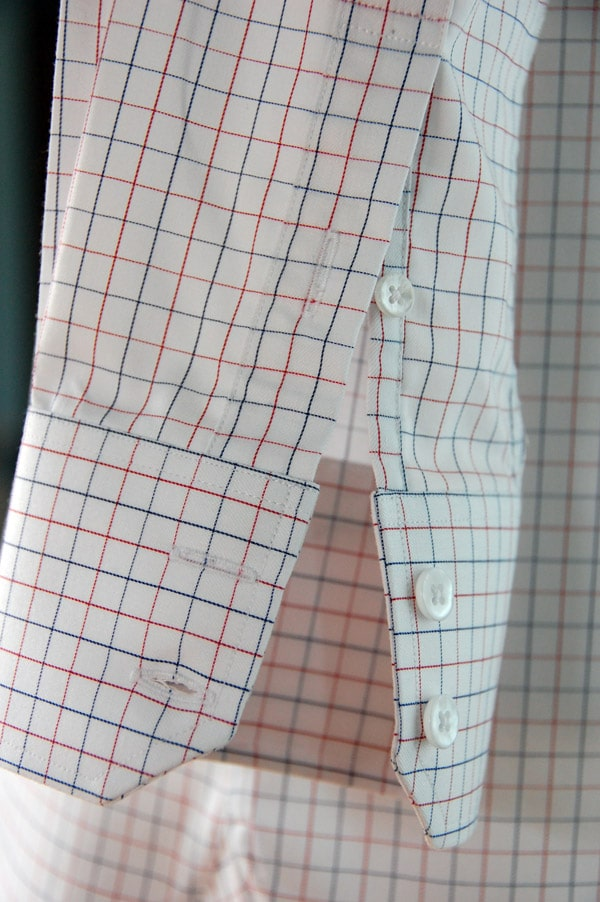 Dress shirt sleeve with cuff button.