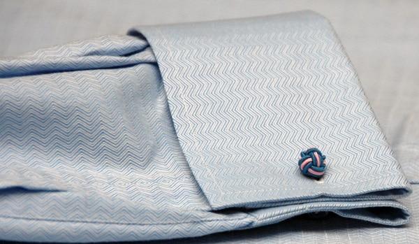 Cuffs knot dress shirt sleeve.