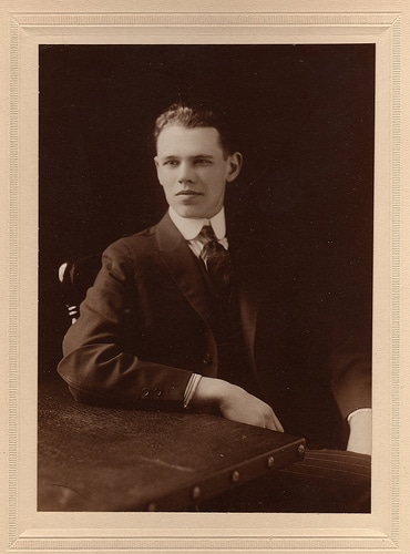 Young man sitting on chair portrait.
