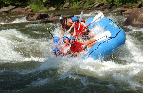 whitewater rafting guide raft tipping over rapids