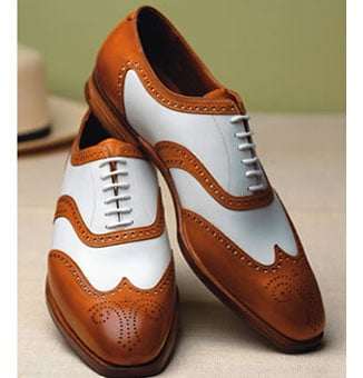 brown and white saddle derby shoes