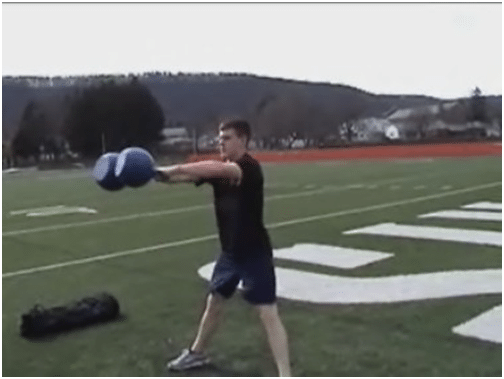 Man doing exercise of kettlebell in the ground.