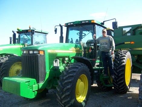 Brian Bradley farmer with john deere tractor.