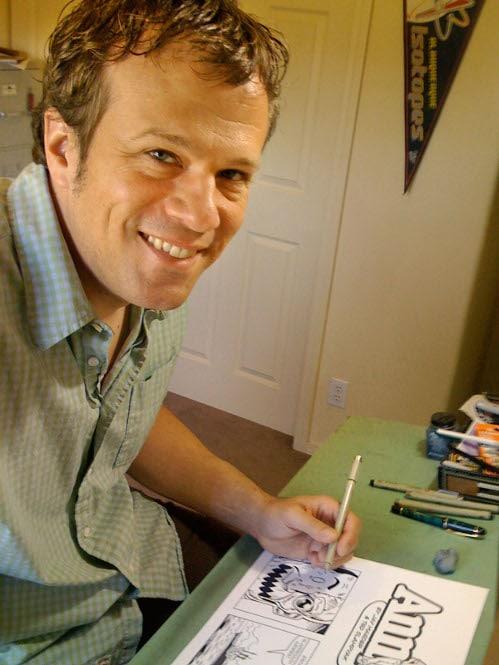 Ted Slampyak artist in his office.