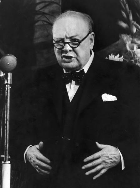 Winston churchill giving instense speech with glasses.