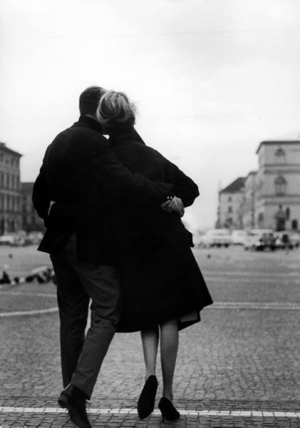 Vintage couple romantic hugging outside cool weather.