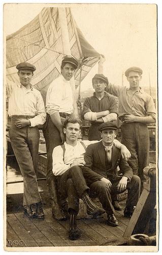 Vintage group of men at dock.