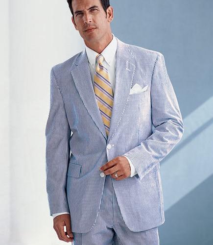 Man wearing Seersucker suit with tie summer dress outfit.