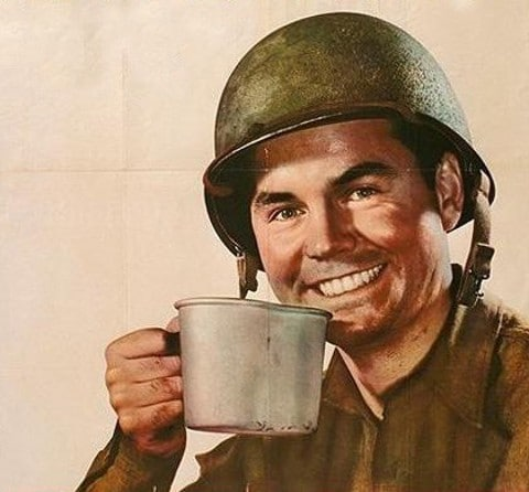 vintage soldier gi drinking coffee from tin mug