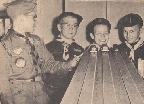 Vintage pinewood derby boy scouts enjoying.
