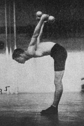 Vintage man doing dumbbell workout in gym.