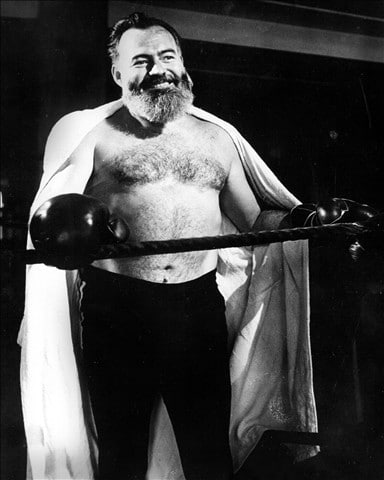Ernest Hemingway wearing boxing gloves for practice.
