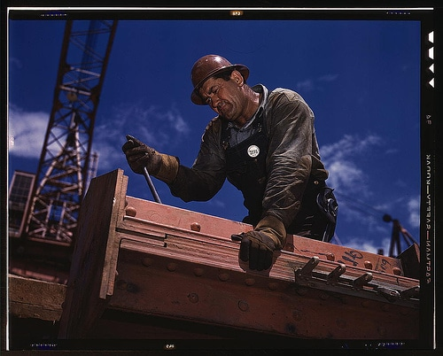 Vintage construction worker fixing a iron claps.