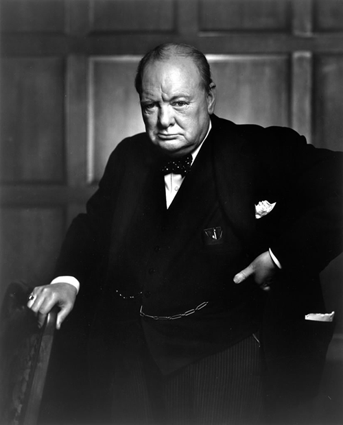 Winston Churchill's portrait while holding chair.