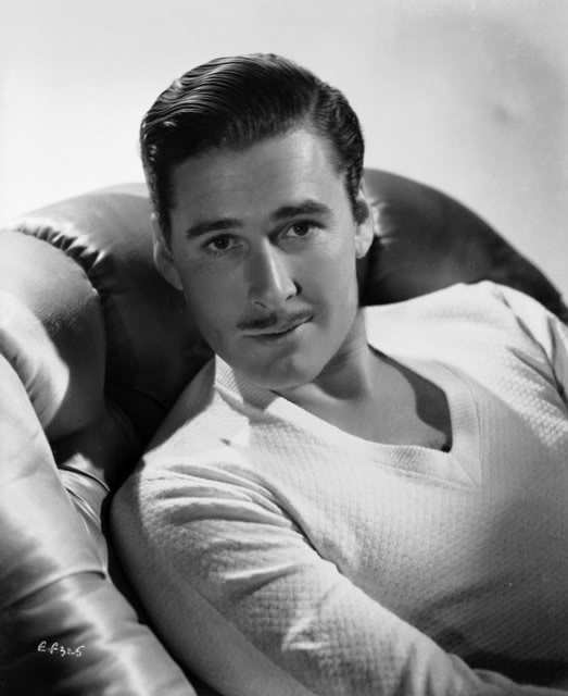 Actor Errol Flynn posing with mustache.