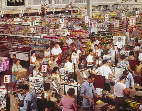 Vintage grocery store being crowded.