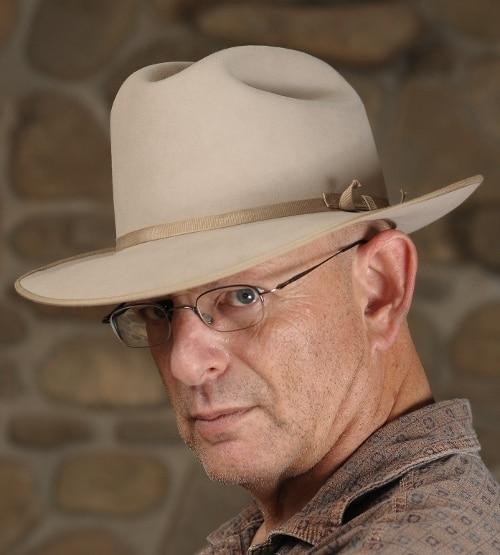 Dean Zatkowsky ghostwriter posing while wearing cowboy's hat.