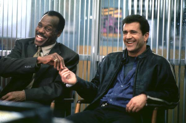 Lethal Weapon movie scene of Mel Gibson and Danny Glover.