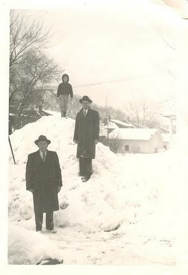 vintage 3 generations of men standing in snow bank
