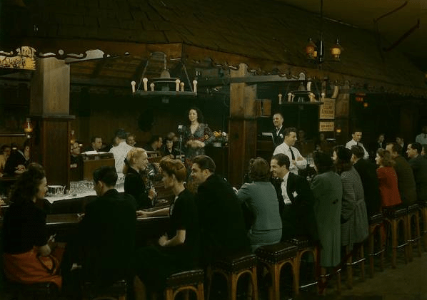 Vintage bar crowded with people.