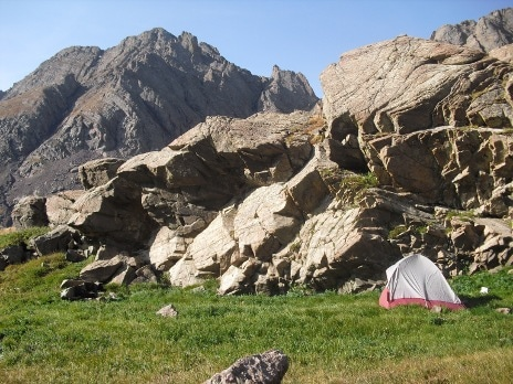 mountain climbing basics primer tent under cliffs