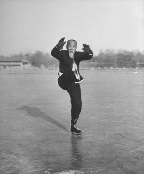 Vintage asian old man doing kung fu while ice skating.