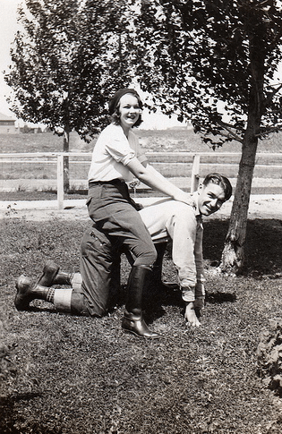 Vintage couple playing in yard.